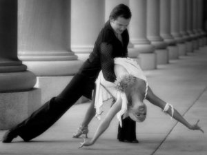 Does this holding this position look easy to you? Because it's not. (Image from Ballroom Dance Chicago blog)