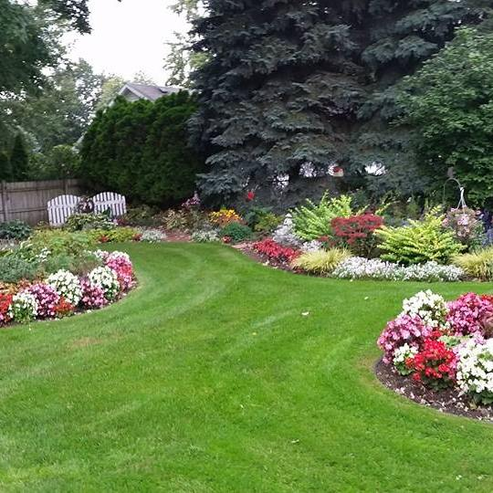 I grew up playing in this lush, vibrant garden that is my great-grandparents' yard.  Over forty years of love and care have made it unsurpassably beautiful.