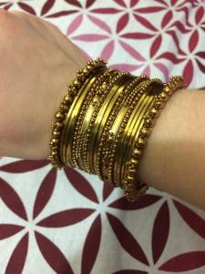 There are a variety of ways to wear sets of bangles, often a matching set on each arm. Women often coordinate their bangles with their sarees (or other outfits). If anyone knows how to accessorize, it is definitely Indian women!